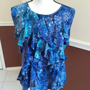 Ladies sleeveless dressy blouse.